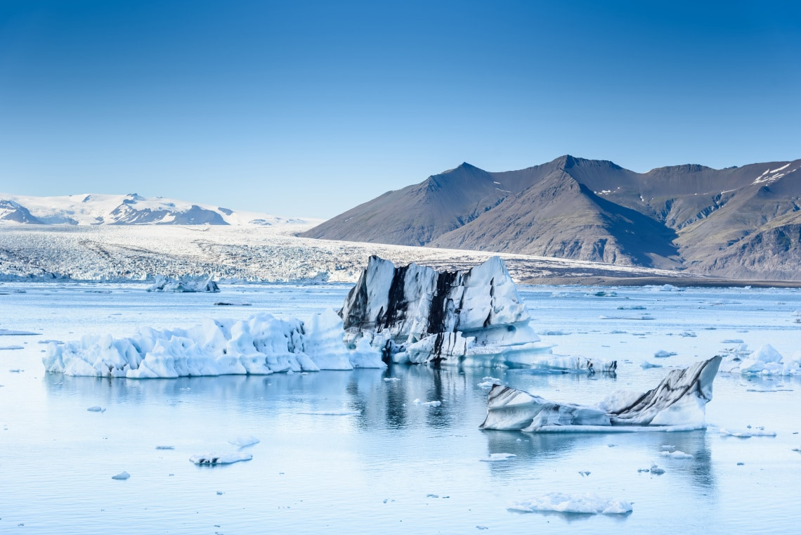 Beautiful view of icebergs in glacier lagoon, Iceland, selective focus, global warming and climate change concept