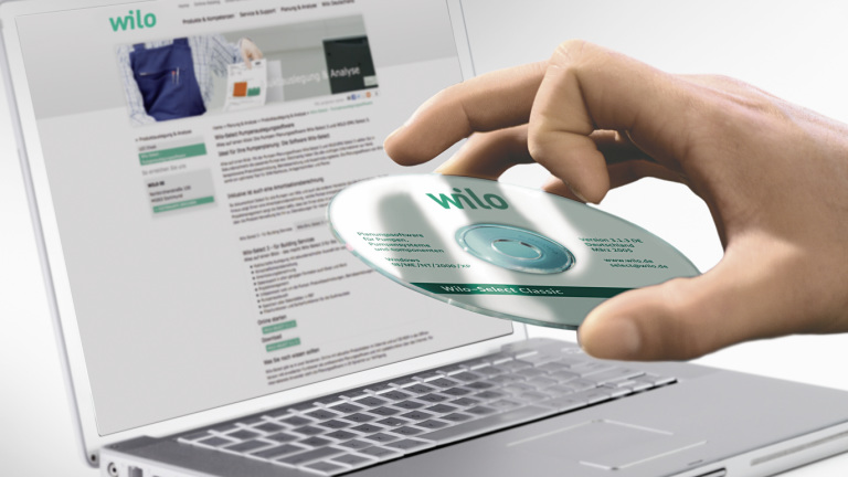 Laptop CD-ROM in hand